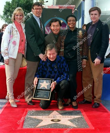 DEFOREST KELLEY DeForest Kelley, center, who plays Dr. ''Bones'' McCoy in the Star Trek series and motion pictures, poses with Star Trek cast members, from left, Grace lee Whitney, Leonard Nimoy, George Takei, Nichelle Nichols, and Walter Koenig after receiving a star in the Walk of Fame in Hollywood, Calif. on