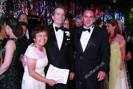 Stock Image of Lou Lazatin, Patrick Wayne and Ethan Wayne