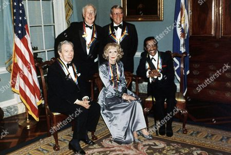 The artists selected to receive the Kennedy Center Honors of 1987 pose during a State Department reception on in Washington, USA. the Honorees standing are choreographer Alwin Nicolais, left, and singer Perry Como. Seated are, L-R: violinist Nathan Milstein, actress Bette Davis and entertainer Sammy Davis Junior