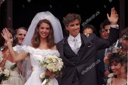 STRAUSS Matthew Maxwell Taylor Kennedy and Victoria Strauss Kennedy wave to the crowd shortly after getting married at the Cathedral Basilica of Saints Peter and Paul, in Philadelphia, Pa., on . The groom is the son of the late Senator Robert F. Kennedy