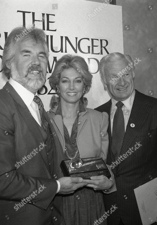 Country music star Kenny Rogers, left, who has pledged to give $1 million in world hunger awards over the next 10 years, presented the first set of annual prizes at the United Nations, . Rogers and his wife, Marianne, center, are shown with Eddie Albert