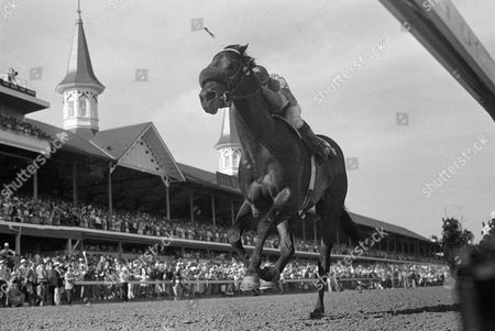 Spend a Buck, with jockey Angel Cordero, Jr. in the irons, approaches the finish to win the 111th running of the Kentucky Derby in Louisville, . Spend a Buck completed the Run for the Roses in 2 minutes and 1.5 seconds