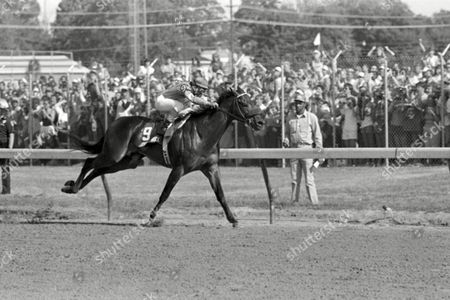 Spend a Buck, with Angel Cordero, Jr. up, crosses the finish at Churchill Downs to win the 111th running of the Kentucky Derby