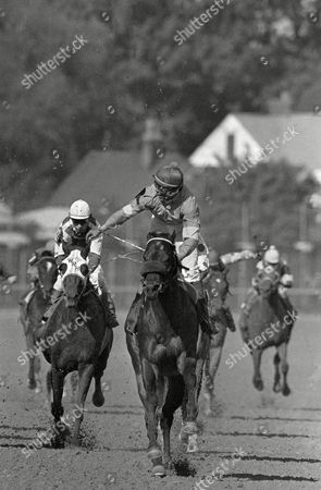Jockey Angel Cordero Jr. stands up in the irons to salute the Churchill Downs crowd after riding Spend a Buck to victory in the Kentucky Derby in Louisville, . Spend a Buck finished the mile and a quarter in 2 minutes, 1.5 seconds - the third-fastest Derby ever run