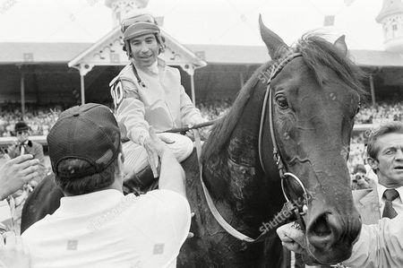 Laffit Pincay, Jr., is congratulated on his way to the winner's circle after he rode Swale to victory in, Kentucky Derby at Churchill Downs in Louisville