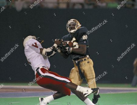 Notre Dame's Raghib Ismail (25) catches a 52-yard pass covered by Virginias Jason Wallace in the first quarter of Kickoff Classic play at Giant Stadium in East Rutherford, New Jersey, . Notre Dame scored on the next play