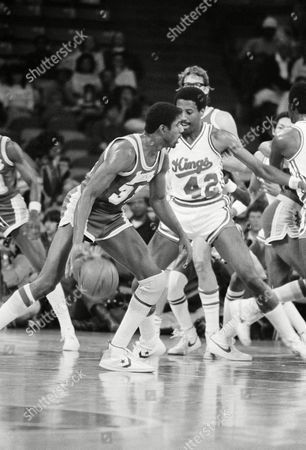"""Kings Mike Woodson, right, bumps with Lakers Earvin """"Magic"""" Johnson as he tries to keep him from scoring during game in Kansas City, . Johnson ended up with 29 points in the Lakers 109-97 win"""