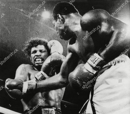 Larry Holmes, Leon Spinks Heavyweight champion Larry Holmes pounds challenger Leon Spinks against the ropes during the third round of their title fight at Joe Louis Arena in Detroit, . Holmes defeated Spinks by a TKO in the round
