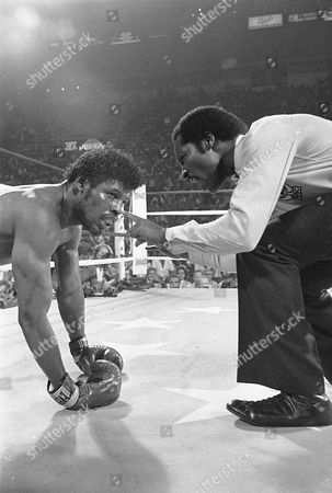 Leon Spinks, Richard Steele Referee Richard Steel counts out challenger Leon Spinks after he was hit by WBC Heavyweight Champion Larry Holmes in the third round of their scheduled 15-round title bout at Detroit's Joe Louis Arena, . Holmes won the fight with a third round TKO