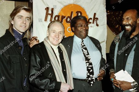 Newcomer guitarist Eric Johnson, left, who received the Les Paul Horizon award for the most promising new guitarist poses with guitar legend Les Paul center, blues great B.B King, right who won the Orville H. Gibson lifetime achievement award at a benefit for Nordoff Robbins music therapy at the Hard Rock Cafe in New York, . Richie Havens is at far right
