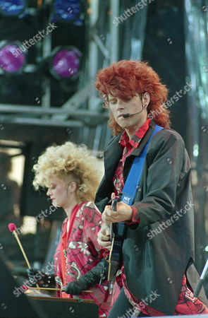 Currie Bailey The Thompson Twins' Alannah Currie, left, and Tom Bailey perform during the Live Aid concert for famine relief at JFK Stadium in Philadelphia, Pa