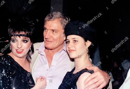 """Entertainer Liza Minnelli is shown with actor Gene Barry and his daughter Liza Barry during a party hosted by Minnelli in honor of Chita Rivera, who won a Tony for """"The Rink,"""" in New York"""