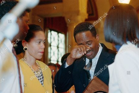Gregory Alan Williamsdddddd Gregory Alan Williams, one of four people honored in Los Angeles, by the City Council for helping rescue motorists from angry mobs in riots last week, wipes a tear from his eyes after delivering an emotional speech before the council. Looking on is another Good Samaritan, Lei Yuille