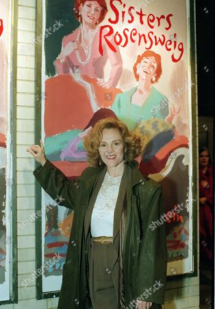 """Kahn Actress Madeline Kahn poses in front of a poster for """"The Sisters Rosensweig,"""" in which she stars, at the Mitzi E. Newhouse Theater at Lincoln Center in New York City on"""