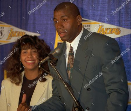 """Stock Picture of JOHNSON Earvin """"Magic Johnson"""" and his wife Cookie are shown at a news conference in Inglewood, Calif., where Johnson announced he would return as a player for the Los Angeles Lakers. He later retired again from the team. In an article in Ebony Magazine, Cookie Johnson says her husband has recovered from the AIDs virus.Johnson's HIV infection has dropped to undetectable levels because of drug therapy, doctors say. Lon Rosen, agent for the former Los Angeles Lakers star, confirmed: ''Earvin's viral activity is infinitesimal"""