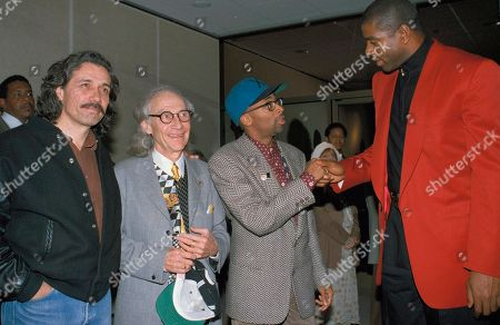 """Stock Photo of Olmos Worth Johnson Lee Filmmaker Spike Lee, second from right, greets former Los Angeles Laker Earvin """"Magic"""" Johnson, right, at a Hollywood celebrity screening of Lee's """"Malcolm X"""" in Beverly Hills, Calif., . At far left is actor James Edward Olmos and producer Marvin Worth"""