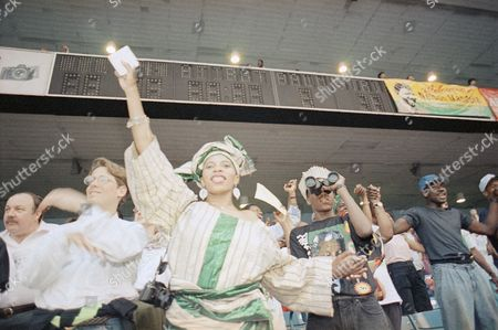 Spectators join in the action as they listen to singer Melba Moore during a concert for Nelson Mandela in New York's Yankee Stadium