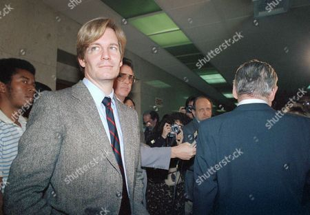 Marc Christian Ignoring the press, Marc Christian, left, waits while his lawyer Harold Rhoden makes a statement outside a Los Angeles courtroom, after a jury awarded Christian $14.5 million from the estate of Rock Hudson. Christian, the lover of the late actor who died of AIDS, had sought $11 million