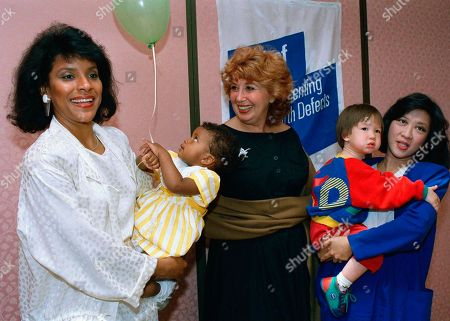 Phylicia Rashad, Phylea Rashad, Beverly Sills, Kaity Tong Phylicia Rashad, left, of the Cosby Television show, holds daughter Phylea, 2, as she joins Beverly Sills and anchorperson Kaity Tong of WABC-TV, right, holding son, Philip, 2, at the March of Dimes celebration of its 50th anniversary in New York on . Sills, chairman of the golden anniversary celebration, led other media moms and the children in commemorating the charity?s fine work