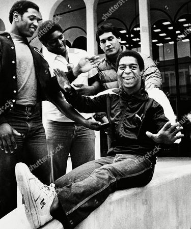 USC Trojan Marcus Allen, sitting right, clowns with defensive tackle Dennis Edwards, left, offensive linebacker Byron Darby; and nose guard George Achica, standing right; recently on the USC campus, Los Angeles, Calif. Allen became the first player in college football history to rush for more than 200 yards in four consecutive games
