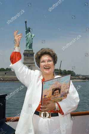 """Marilyn Horne Marilyn Horne sings """"God Bless America"""" as she stands on the top deck of the Enticer as it sails past the Statue of Liberty, New York. Horne is holding a copy of her album """"Beautiful Dreamer - The Great American Songbook"""