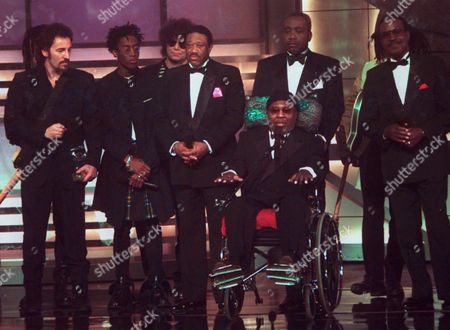 CURTIS MAYFIELD R&B legend Curtis Mayfield, in wheelchair, is surrounded by musicians who where influenced by his music, including Bruce Springsteen, at left, after Mayfield was honored with a Grammy Legend Award at the 36th Annual Grammy Awards ceremonies at New York's Radio City Music Hall in this photo