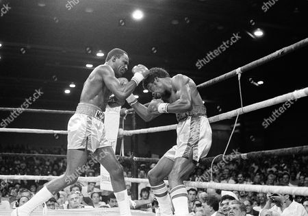 Mike McCallum of Jamaica retained his World Boxing Association junior middleweight title in Miami Beach by stopping Julian Jackson of the U.S. Virgin Islands in the second round, . McCallum, left, keeps Jackson against the ropes just before referee Eddie Eckert stopped the fight