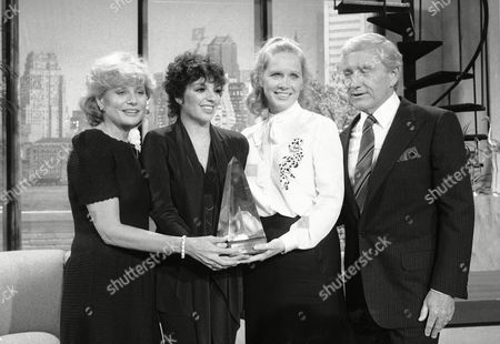 Ullman Minnelli Walters Griffin Talk show host Merv Griffin, far right, is shown with newswoman Barbara Walters, entertainer Liza Minnelli and actress Liv Ullman, as he presents the Celanese Meridian Award backstage of his television show in New York