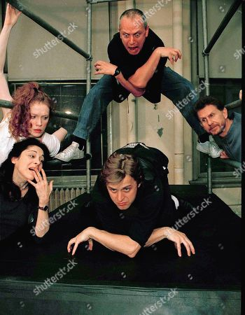 "Stock Photo of Dancer Mikhail Baryshnikov, on mat at bottom center, is coached by director Steven Berkoff, overhead, in a New York studio during rehearsals for his dramatic debut in Berkoff's adaptation of Kafka's ""Metamorphosis,"" . Also pictured are actresses Laura Esterman, left, and Madeleine Potter, and actor Rene Auberjonois, right. ""Metamorphosis"" deals with a man who wakes to find himself inexplicably transformed into a giant cockroach"