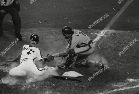 Gary Carter, Glenn Davis Houston Astros first baseman Glenn Davis is tagged out by New York Mets catcher Gary Carter as Davis was thrown out trying to score on an Alan Ashby single in the third inning of their game in Houston
