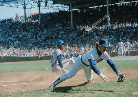 Darryl Strawberry, Ron Cey New York Mets' outfielder Darryl Strawberry is safe at third as Chicago Cubs' third baseman Ron Cey misses a wild throw from outfielder Thad Bosley during fifth inning action in Chicago, . The Mets won, 9-3
