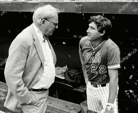 Stock Image of Ray Knight, (22), newly acquired New York Mets player, says hello to General Manager Frank Cashen, left, in front of the dugout at Shea Stadium before Wednesdays game with the Los Angeles Dodgers, New York. Cashen negotiated a trade with the Houston Astros for Knight Tuesday. Knight was to start the game at third base, with third baseman Hubie Brooks moving to shortstop for the first time in his Major League career