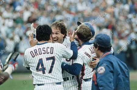 Gary Carter of the New York Mets, center, celebrates with relief pitcher Jesse Orosco, left, after Carter won Game 5 of the National League Championship Series with a twelfth inning hit against the Houston Astros, New York. Orosco got the save for Dwight Gooden as the Mets won the game 2-1