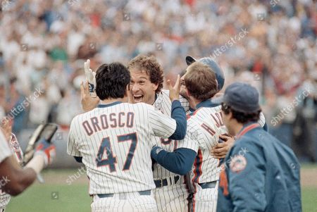 Gary Carter of the New York Mets, center, celebrates with relief pitcher Jesse Orosco, left, after Carter won Game 5 of the NL Championship Series with a twelfth inning hit against the Houston Astros, New York. Orosco got the save for Dwight Gooden as the Mets won the game 2-1