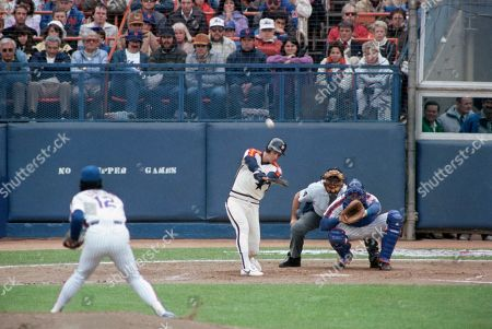 Houston Astros baseman Bill Doran, center, connects for a two-run homerun against the New York Mets in the second inning of Game 3 of the NL Championship Series, New York. The homer off of Mets pitcher Ron Darling scored Astros shortstop Craig Reynolds