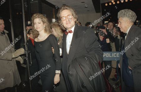 "Actor Michael Douglas, right, escorts his wife, Diandra, into the Loew's Astor Plaza, in New York for the world premiere of the movie, ""Rain Man."" The film stars Dustin Hoffman and Tom Cruise, and profits from the premiere are going towards cancer research"