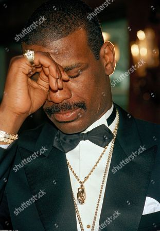 Michael Spinks Heavyweight boxer Michael Spinks wipes his eyes as he listens to speeches of praise during a news conference at New York's Tavern on the Green, during which Spinks announced his retirement from the ring. Spinks lost his last professional bout to Mike Tyson June 27