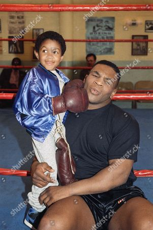 Mike Tyson, Emmanuel Lewis Emmanuel Lewis from the ABC-TV series ?Webster? punches the chin of newly crowned WBC heavyweight champion Mike Tyson during a break in taping the show in Los Angeles