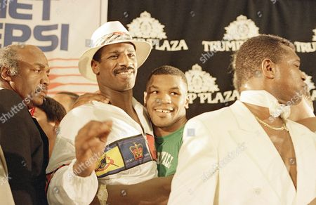 Mike Tyson, Michael Spinks Mike Tyson, right, embraces Michael Spinks at a post-fight news conference in Atlantic City, . Tyson knocked out Spinks in the first round of their world heavyweight championship fight