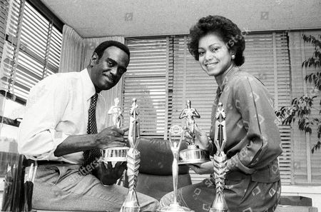 MINGO JONES Frank Mingo and Caroline Jones pose in September 1982 in their New York City apartment with some of the trophies they won for their best ad campaigns. The pair has built a black-owned ad agency that now boasted such clients as Kentucky Fried Chicken and Miller Brewing, and after only five years had an annual billing of $15 million