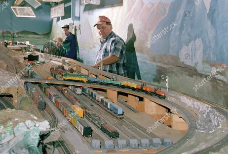 Richard Cousins Richard Cousins, foreground, controls a train through his area of tracks at the Gowanda-Buffalo Model Train club on in Gowanda, New York. The club, in operation since 1961, meets each on Friday to operate their Ho-guage model trains. In the rear is Joe Parisio