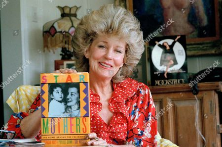 "Georgia Holt Georgia Holt, mother of Academy Award-winning actress Cher, displays her new book ""Star Mothers"" during an interview in Los Angeles, . After she learned that she and other mothers of stars are always asked the same questions about their famous offspring she decided to do something about it"