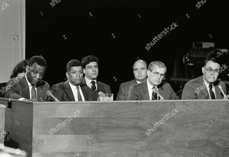 Philadelphia's city government leaders testify before the special commission investigating the police siege of the radical group MOVE's headquarters in Philadelphia, . Shown from left, in front row are: Mayor W. Wilson Goode; former managing director Leo Brooks; Fire Commissioner W. William Richmond; and Police Commissioner Gregore Sambor. In background are, from left: attorneys Jeffrey Miller and Carmen Nasuti, representing Richmond