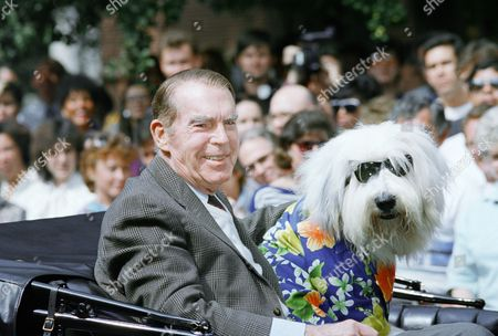 """Fred MacMurray Fred MacMurray and the """"Shaggy Dog"""" arrive at Walt Disney Studios in Burbank, Calif., where MacMurray, whose film debut with the company was the hit """"The Shaggy Dog,"""" became the first recipient to be honored along the Disney Legends Promenade. The tribute is to be given to individuals whose time-honored body of work epitomizes the Disney product"""