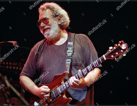 """GARCIA Grateful Dead lead singer Jerry Garcia performing in Oakland, Calif. Garcia, who died on Aug. 9, 1995, Cyndi Lauper and Toby Keith will be inducted into the Songwriters Hall of Fame in June. The organization announced Wednesday that Linda Perry, country music songwriter Bobby Braddock and """"Hoochie Coochie Man"""" writer Willie Dixon will also be inducted on June 18"""