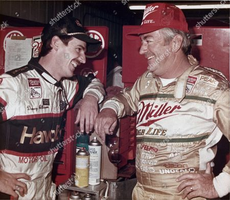 Davey Allison, left, of Hueytown, Al. talks with this father Bobby Allison after a practice round at the Miller High Life 500 NASCAR race at Pocono International Raceway in Long Pond, Pa