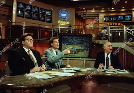 The CBS-TV sports anchors team of Mike Francesa, left, Jim Nantz, center, and Billy Packer join the rest of the sports-viewing nation as they watch action during the NCAA Men's Basketball Championship tournament from their New York studios