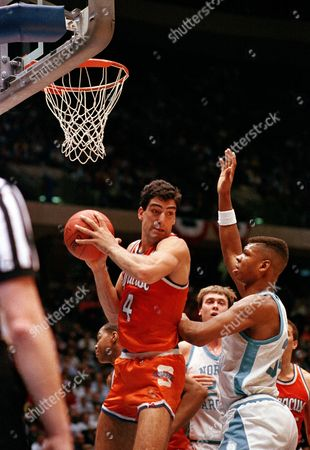 Seikaly Reid Syracuse's Rony Seikaly (4) grabs the rebound as North Carolina's J.R. Reid looks on during the first half of the NCAA East Regional Final in East Rutherford, N.J., . North Carolina's Joe Wolf is at center