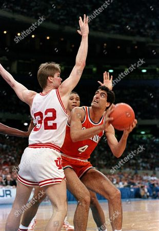 Seikaly Eyl Thomas Syracuse's Rony Seikaly (4) looks to the basket as Indiana's Steve Eyl (32) and Daryl Thomas try to defend during the NCAA Championship game in New Orleans, La., . Indiana won, 74-73, for the national championship