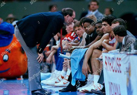 Syracuse coach Jim Boeheim (left) talks to player Rony Seikaly (right) as he sits on the bench during their game against Providence in New Orleans